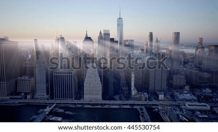 new york city skyline cityscape background. dramatic aerial shot of urban metropolis scenery   - stock photo