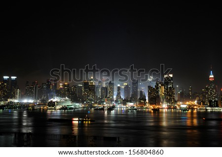 New York City skyline in the fog of night - stock photo