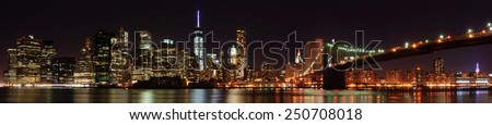 New York City skyline panorama with Brooklyn Bridge - stock photo