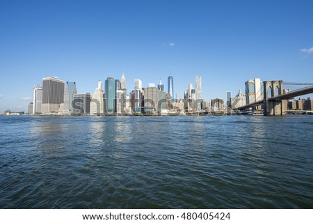 New York City skyline view from Brooklyn of the Manhattan Bridge with East River
