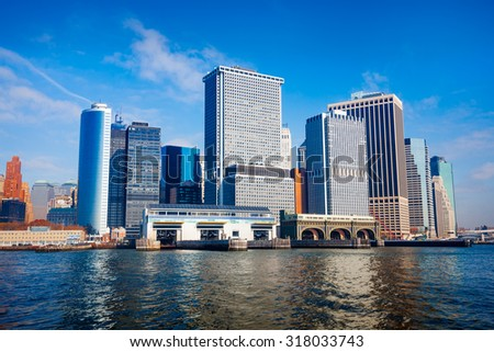 New York City skyline viewed from East River. Cityscape shot on a bright beautiful day.