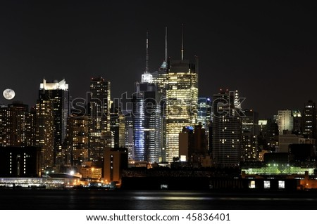 New York City skyline with a rising moon