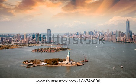 New York city skyline with dramatic sunset sky. - stock photo