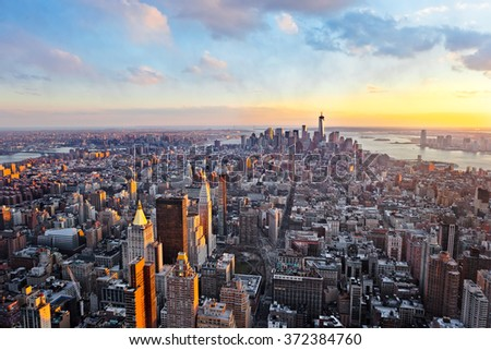 New York City skyline with urban skyscrapers and bay view at sunset - stock photo