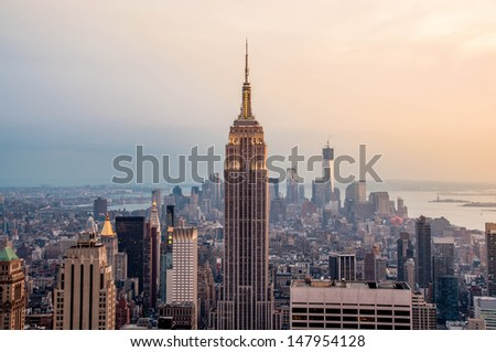 New York City skyline with urban skyscrapers at sunset.  - stock photo