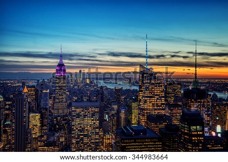 New York City skyline with urban skyscrapers at sunset - stock photo