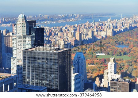 New York City skyscrapers in midtown Manhattan aerial panorama view in the day with Central Park and colorful foliage in Autumn. - stock photo