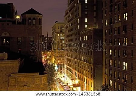 New York City street and housing elevated view at night - stock photo