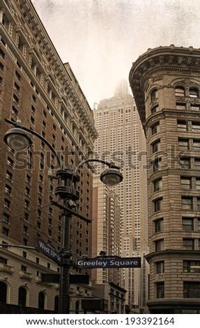 New York City street corner showing beautiful art deco architecture with grunge styling. - stock photo