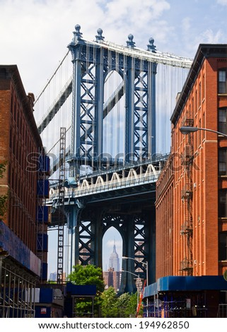 New York City street scene with bridge and buildings in Brooklyn - stock photo