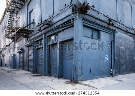 New York City street scene with weathered blue building - stock photo