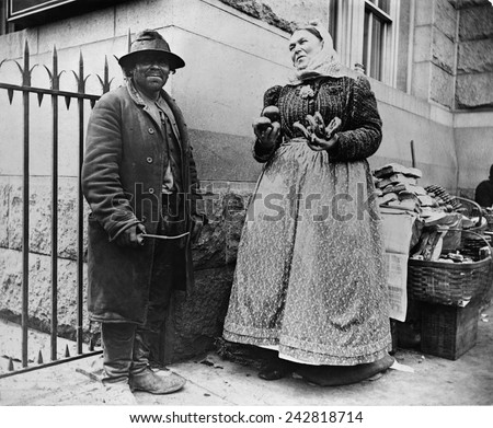 New York City street types: Emigrant man and women pretzel vendor. 1896 photograph by Alice Austen.