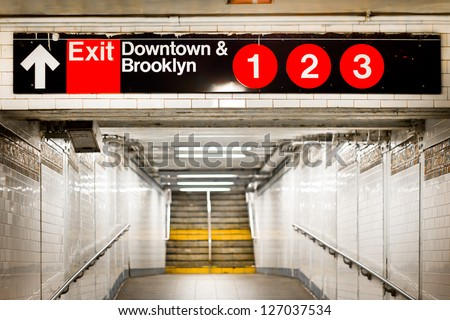 New York City subway passageway and sign to Brooklyn - stock photo