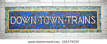 New York city subway sign tile pattern in midtown Manhattan station. - stock photo