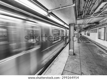 New York City subway train speeding up. - stock photo