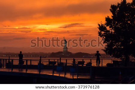 New York City Sunset over The Statue of Liberty - stock photo