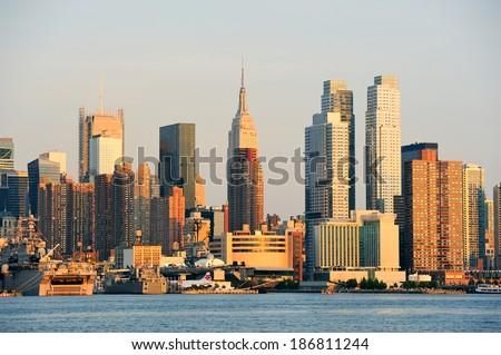 New York City sunset panorama with Manhattan skyline viewed from New Jersey. - stock photo