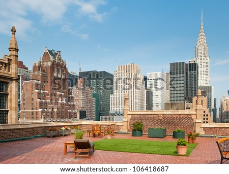 New York City terrace over Manhattan skyline view with Chrysler building in the background.