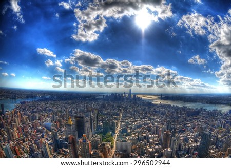 New York City - the skyscrapers and the skyline of Manhattan under the sun in high dynamic range (HDR) through fisheye lens - stock photo
