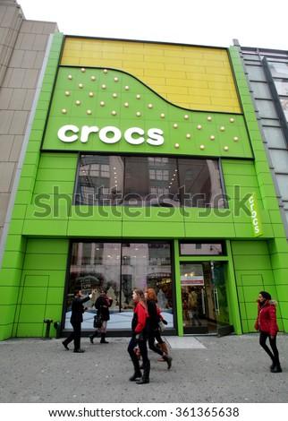 NEW YORK CITY - THURSDAY, DECEMBER 31, 2015: Pedestrians walk past the flagship retail store for shoe manufacturer Crocs, Inc. - stock photo