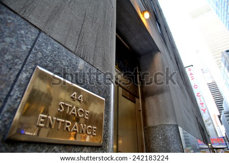 NEW YORK CITY - TUESDAY, DEC. 30, 2014: The stage door of Radio City Music Hall. Radio City is an art deco designed entertainment venue located in Rockefeller Center in New York City - stock photo