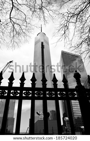 NEW YORK CITY, USA - April 5, 2014: Construction continues on One World Trade Center (as seen from Saint Pauls cemetery) as the landmark building near completion in Lower Manhattan  - stock photo