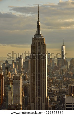 NEW YORK CITY, USA :?? April, 26. 2015 : Empire state building at sunset.  It is a 102-story landmark and American cultural icon in New York City. - stock photo