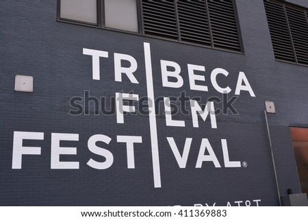 "New York City, USA - April 23, 2016: Sign painted on a building in Lower Manhattan for the annual,  landmark ""Tribeca Film Festival"" in 2016 in New York."