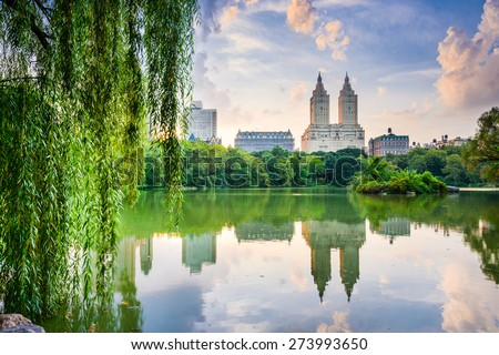 New York City, USA at the Central Park Lake and Upper West Side skyline. - stock photo