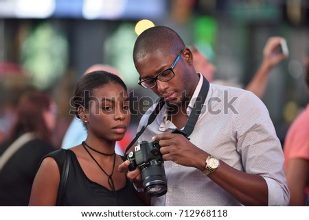 NEW YORK CITY, USA - AUG. 26 : Unidentified people on the Times Square in Manhattan on August 26, 2017 in New York City, NY. Times Square is a major tourist destination and entertainment center in NYC