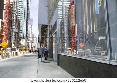 NEW YORK CITY,USA-AUGUST 5,2013:city life in a metropoli.People and tourists moving between the skyscrapers to get to work or to visit the city of New York during a sunny day. - stock photo