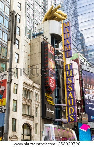NEW YORK CITY, USA - AUGUST 2, 2013:Madame Tussauds in time square in the daylight.Time square  is full of advertising signs,billboard, traffic and people walking by shopping or sightseeing. - stock photo