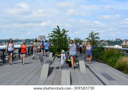 New York City, USA - August 23, 2015: People walking along a path on the High Line on the West Side of Manhattan in New York City. - stock photo