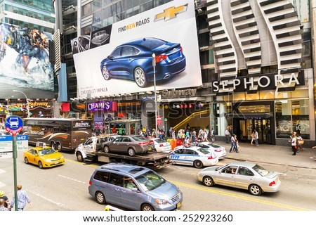 NEW YORK CITY,USA-AUGUST 2, 2013:time square in the daylight is full of advertising signs,billboard, traffic and people walking by shopping or sightseeing. - stock photo