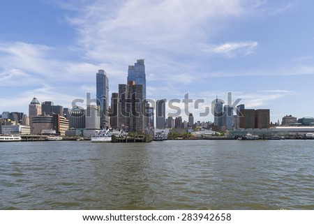 NEW YORK CITY,USA-AUGUST 5,2013:view of south manhattan skyline from boat during a sunny day.