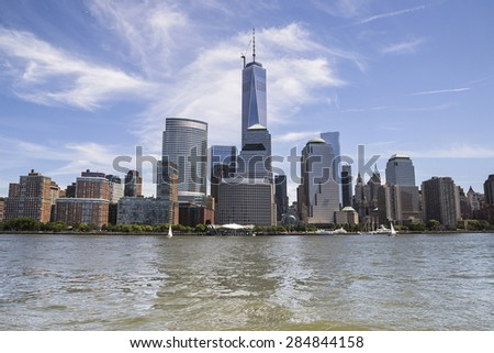 NEW YORK CITY,USA-AUGUST 5,2013:view of south manhattan skyline from boat during a sunny day. - stock photo