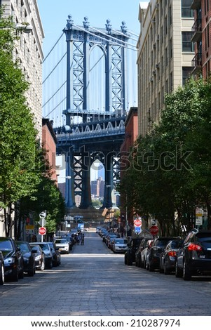 New York City, USA - August 10, 2014: View of the Manhattan Bridge in the Dumbo neighborhood in Brooklyn, New York.  - stock photo
