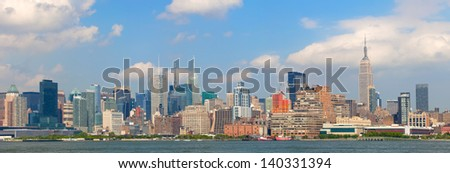 New York City, USA colorful skyline panorama with landmark buildings in downtown business and residential districts with blue sky - stock photo