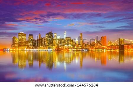 New York City USA, colorful sunset panorama with famous landmark buildings - stock photo