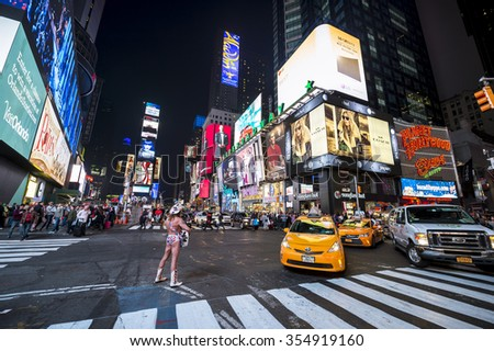 NEW YORK CITY, USA - DECEMBER 22, 2015: Bright signage flashes over holiday crowds and traffic as Times Square gets prepared for New Year's Eve celebrations. - stock photo