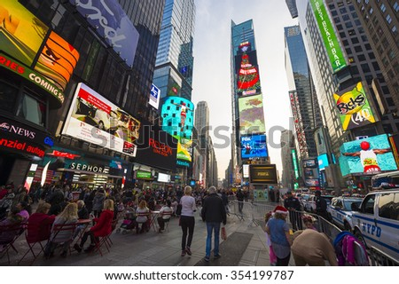 NEW YORK CITY, USA - DECEMBER 13, 2015: Bright signage flashes over holiday crowds as Times Square gets prepared for New Year's Eve celebrations.