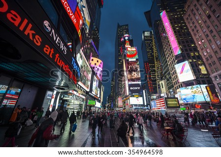NEW YORK CITY, USA - DECEMBER 22, 2015: Crowds gather under the bright lights of Times Square in the build-up to New Year's Eve.