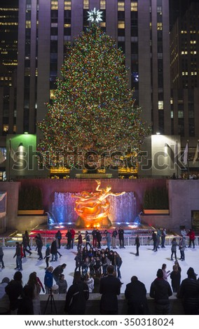 NEW YORK CITY, USA - DECEMBER 10, 2015: Ice skaters fill the skating rink under the Rockefeller Center Christmas tree, a popular holiday tourist attraction in Midtown Manhattan. - stock photo