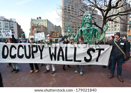 NEW YORK CITY, USA - DECEMBER 17 2011: Occupy Wall Street, protesting financial malfeasance, marked its 90 day anniversary with marches in Manhattan. Occupy banner moving uptown - stock photo