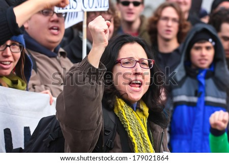 NEW YORK CITY, USA - DECEMBER 17 2011: Occupy Wall Street, protesting financial malfeasance, marked its 90 day anniversary with marches in Manhattan. Addressing the troops prior to marching - stock photo