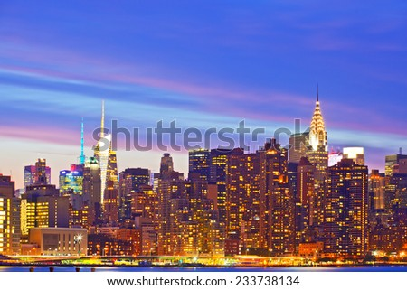 New York City, USA. Downtown buildings in Manhattan with colorful lights, panorama at sunset   - stock photo