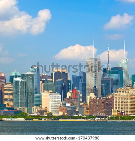New York CIty, USA downtown buildings on a beautiful day with blue sky - stock photo