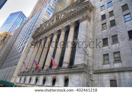 NEW YORK CITY, USA, FEB 6: Wall Street with New York Stock Exchange in Manhattan Finance district in high dynamic range (HDR) in NYC, Feb 6, 2016 - stock photo