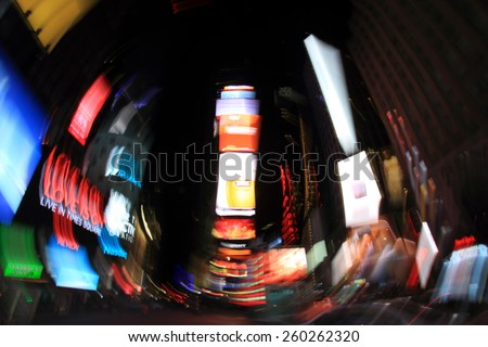 NEW YORK CITY, USA - FEBRUARY 25, 2015: Abstract rotated cityscape of Times Square with commercial signs and electronic billboards on February 25, 2015 in New York City. - stock photo