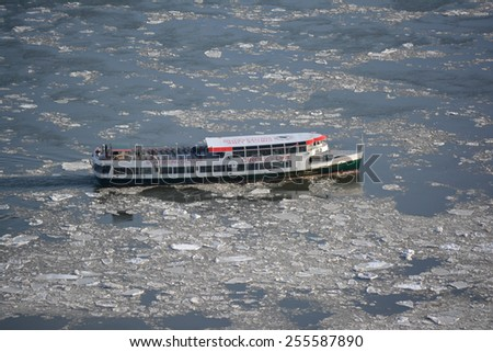 New York City, USA - February 24, 2015: Circle Line cruise ship on the frozen East River as record low temperatures continue in New York City.  - stock photo